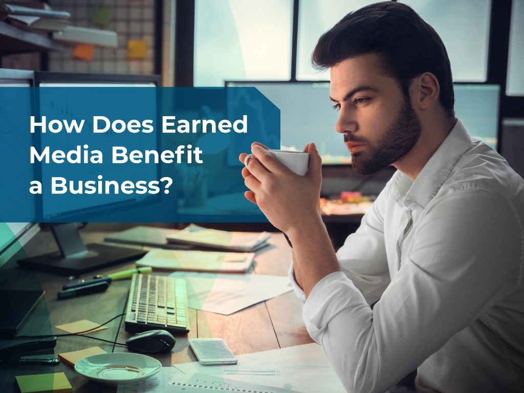 How does earned media benefit a business?